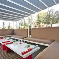 Pérgola Suntech de techo móvil para terraza